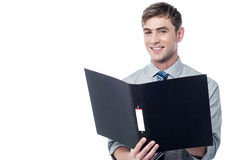 Smiling businessman holding the folder stock image