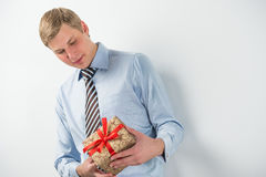 Smiling businessman holding gift box Royalty Free Stock Image