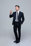 Smiling businessman holding glass of champagne Stock Photo
