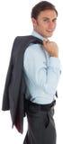 Smiling businessman holding his jacket. On white background Stock Photos
