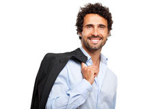 Smiling businessman holding his jacket Stock Images