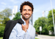 Smiling businessman holding his jacket Royalty Free Stock Photo