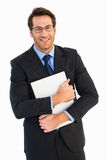 Smiling businessman holding his laptop looking at camera Royalty Free Stock Photo
