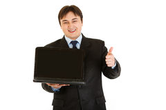 Smiling businessman holding laptops blank screen Royalty Free Stock Image