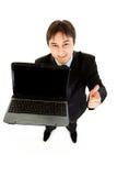Smiling businessman holding laptops blank screen Stock Photo