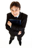 Smiling businessman holding laptops in hand royalty free stock photography