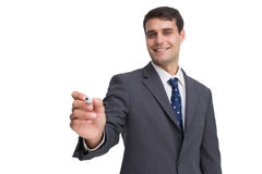 Smiling businessman holding marker and looking at camera Royalty Free Stock Photography