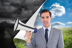 Smiling businessman holding a megaphone Royalty Free Stock Photos