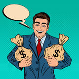 Smiling Businessman Holding Money Bags. Pop Art Stock Images