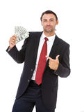 Smiling businessman holding money Stock Photos