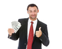 Smiling businessman holding money Royalty Free Stock Image