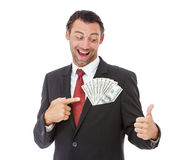 Smiling businessman holding money Stock Images