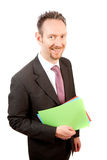 Smiling Businessman Holding Papers Royalty Free Stock Images