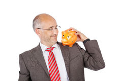 Smiling businessman holding piggy on his shoulder Royalty Free Stock Image