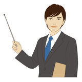 Smiling businessman holding a pointer stick Stock Image