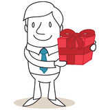 Smiling businessman holding red gift box Royalty Free Stock Images