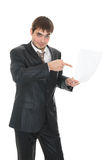 Smiling businessman holding a sheet of paper Royalty Free Stock Image