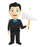 Smiling Businessman Holding A Sign Stock Photo