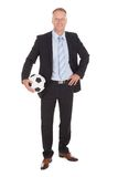 Smiling Businessman Holding Soccer Ball stock images