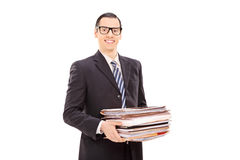 Smiling businessman holding a stack of documents Royalty Free Stock Photos