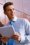 Smiling Businessman Holding Tablet Computer Stock Photo