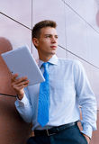 Smiling Businessman Holding Tablet Computer Stock Photography