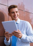 Smiling Businessman Holding Tablet Computer Royalty Free Stock Photo