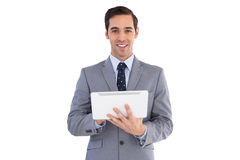 Smiling businessman holding a tablet computer Royalty Free Stock Image
