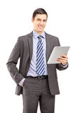 Smiling businessman holding a tablet Stock Images