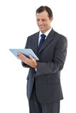 Smiling businessman holding a tablet pc Stock Photo