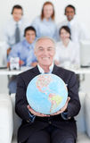 Smiling businessman holding a terrestrial globe Stock Images