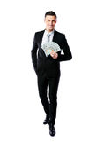 Smiling businessman holding US dollars Stock Photos