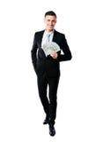 Smiling businessman holding US dollars Stock Photos