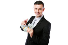 Smiling businessman holding US dollars Royalty Free Stock Photography