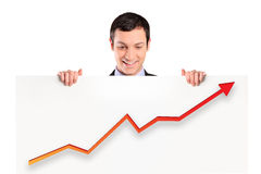 Smiling businessman holding a white panel. A smiling businessman holding a white panel with a growth graph isolated on white background Stock Images