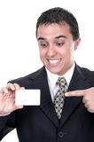 A smiling businessman holds out a credit card Stock Images
