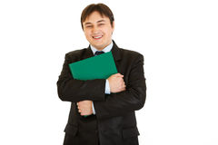 Smiling businessman hugging folder with documents Stock Photos