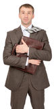 Smiling businessman hugging suitcase Stock Images