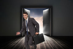 Smiling businessman in a hurry Stock Image