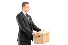 Smiling Businessman In Suit Giving A Box To Someone Royalty Free Stock Image