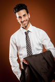 Smiling businessman with jackt in his hands Stock Photography