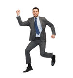 Smiling businessman jumping. Business and education concept - smiling businessman jumping Stock Photo