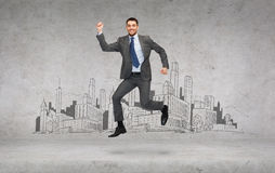Smiling businessman jumping Stock Image
