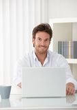 Smiling businessman with laptop Royalty Free Stock Photo