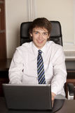 Smiling businessman with laptop Stock Image