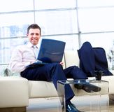 Smiling businessman with laptop Royalty Free Stock Photos