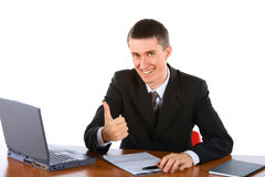 Smiling businessman with laptop Stock Images