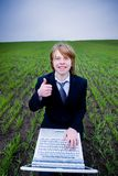 Smiling businessman with laptop Royalty Free Stock Photography