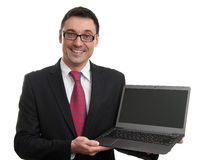 Smiling businessman with laptop computer Stock Photos