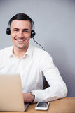 Smiling businessman with laptop and headphone Royalty Free Stock Images